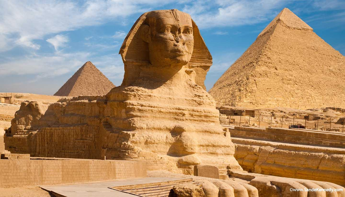 A beautiful profile of the Great Sphinx including the pyramids of Menkaure and Khafre in the background in Giza, Cairo, Egypt