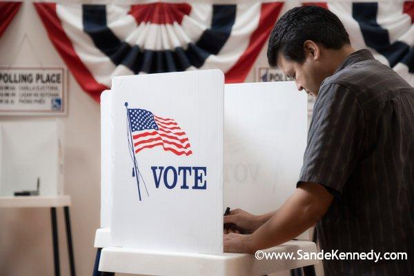 Mixed race voter voting in polling place